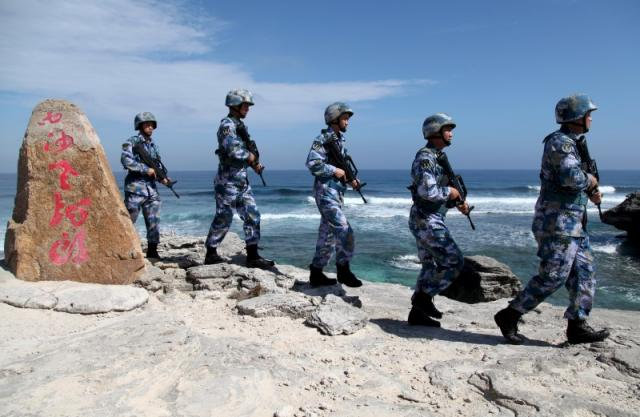 Soldiers of China's People's Liberation Army (PLA) Navy patrol at Woody Island, in the Paracel Archipelago, which is known in China as the Xisha Islands, January 29, 2016. REUTERS/Stringer